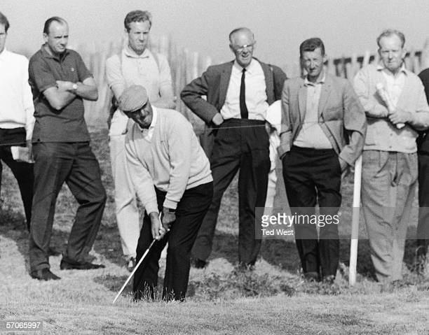 Argentinian golfer Roberto DeVicenzo chipping on the edge of the fourth creek during the second round of the British Open Championship at Hoylake...