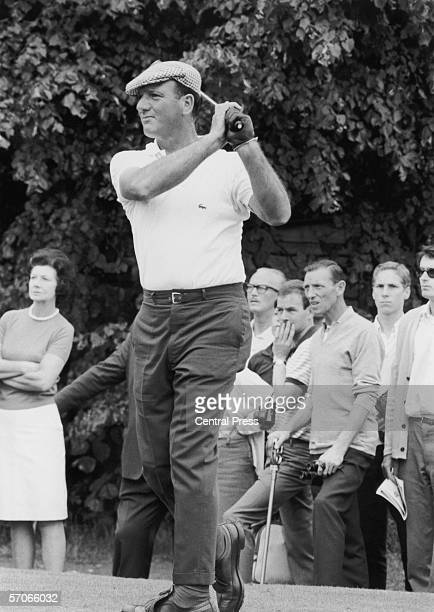 Argentinian golfer Roberto DeVicenzo driving from the sixth tee at Moor Park Rickmansworth during his British Open Championship match with Tony...