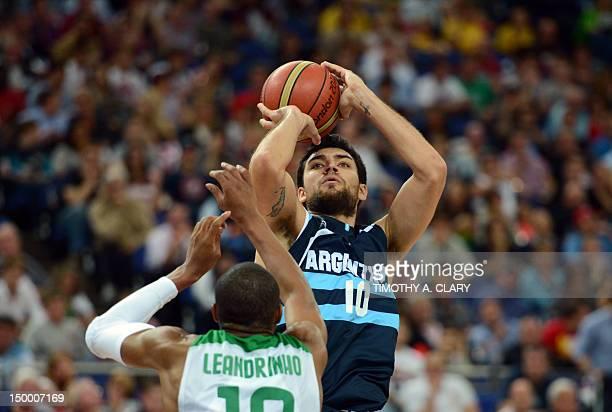 Argentinian guard Carlos Delfino tries to shoot past Brazilian guard Leandrinho Barbosa during their London 2012 Olympic Games men's quarterfinal...