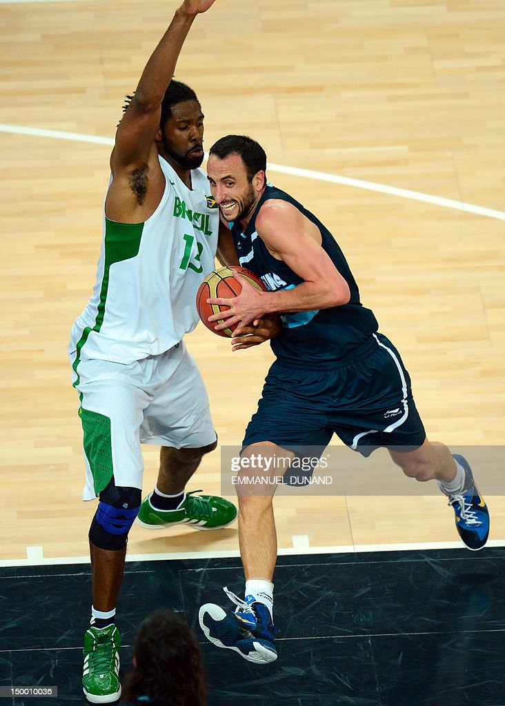 Argentinian guard Emanuel Ginobili (R) is challenged by Brazilian centre Nene Hilario during their London 2012 Olympic Games men's quarterfinal basketball match in London on August 8, 2012.