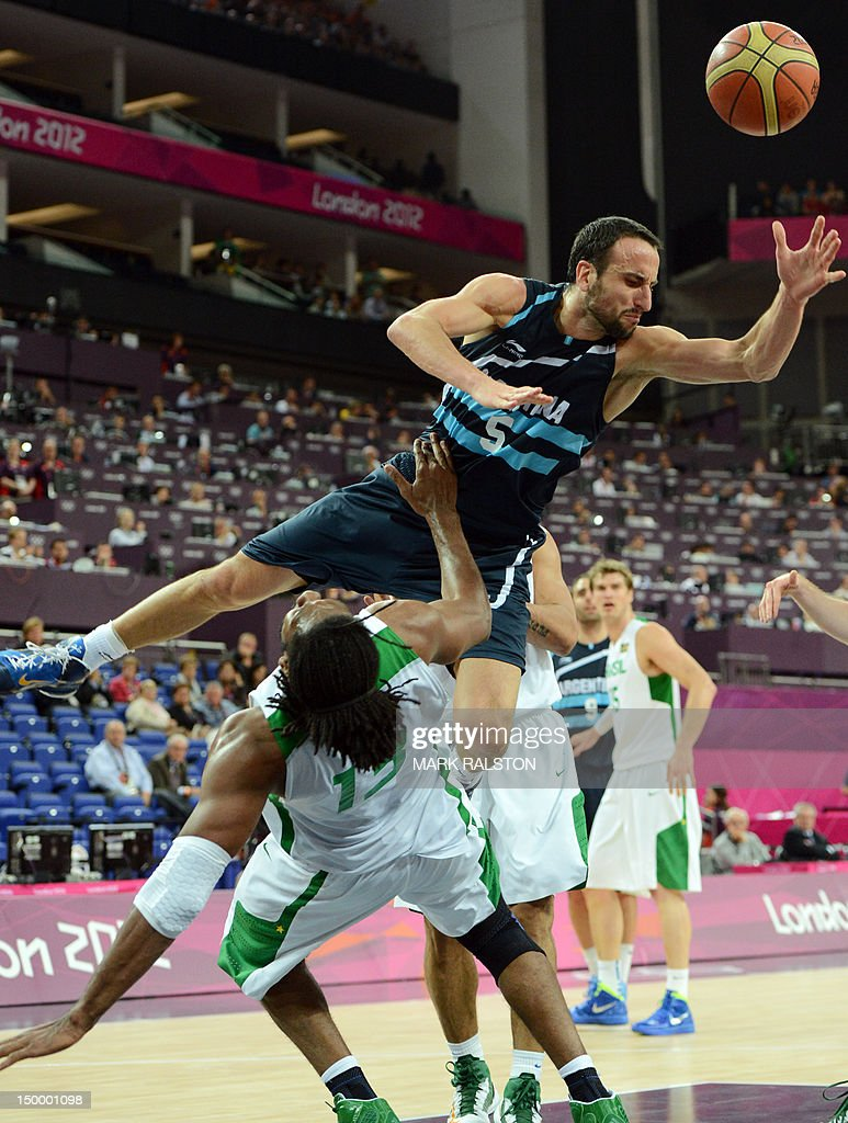 Argentinian guard Emanuel Ginobili vies with Brazilian centre Nene Hilario during their London 2012 Olympic Games men's quarterfinal basketball match in London on August 8, 2012. AFP PHOTO /MARK RALSTON
