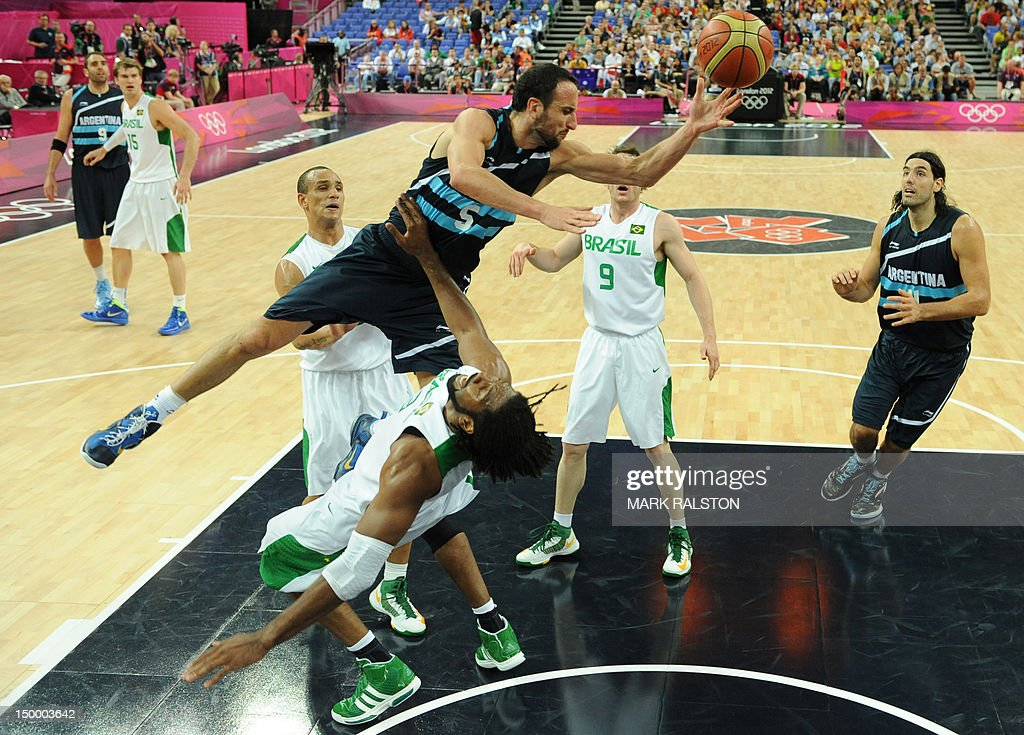 Argentinian guard Emanuel Ginobili (top) vies with Brazilian centre Nene Hilario during their London 2012 Olympic Games men's quarterfinal basketball match in London on August 8, 2012.