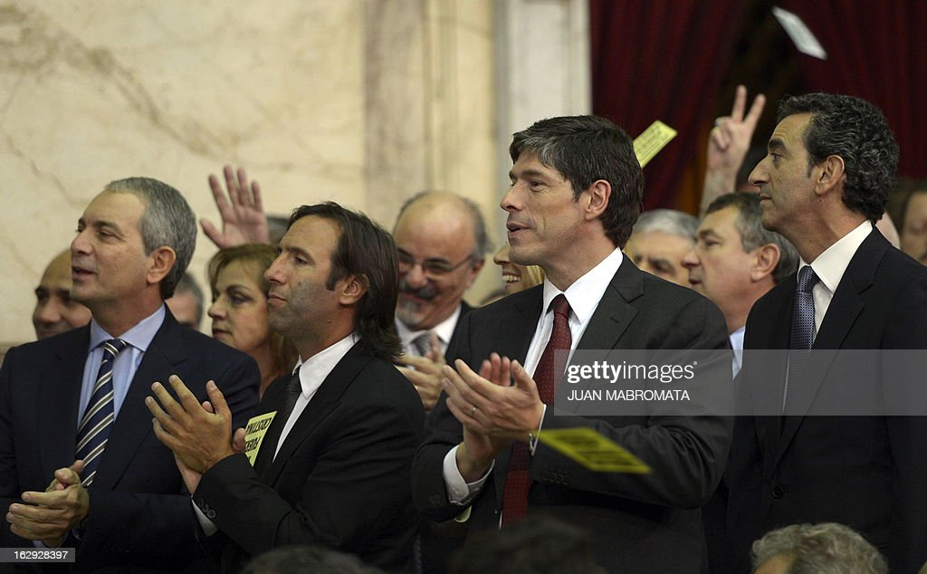 Argentinian Ministers (L-R) Julio Alak, of Justice, Hernan Lorenzino of Economy, Chief Cabinet Juan Abal Medina and Florencio Randazo of Transport attend the inauguration of the 131th period of ordinary sessions at the Congress in Buenos Aires on March 1, 2013. AFP PHOTO / Juan Mabromata