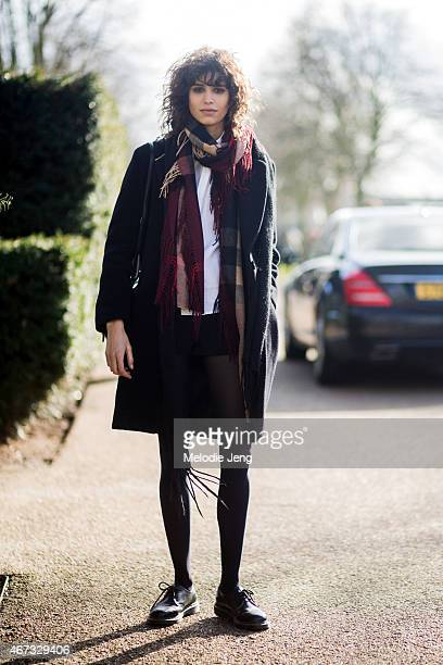 Argentinian model Mica Arganaraz exits the Burberry Prorsum show with a Burberry scarf during London Fashion Week Fall/Winter 2015/16 at Kensington...