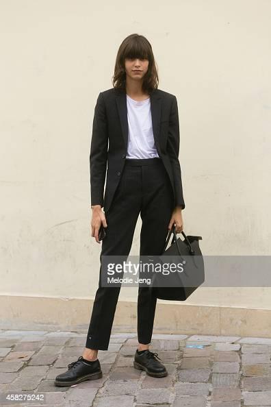 Argentinian model Mica Arganaraz exits the Sacai show carrying a Celine purse at Le Couvent des Cordeliers on Day 7 of Paris Fashion Week...