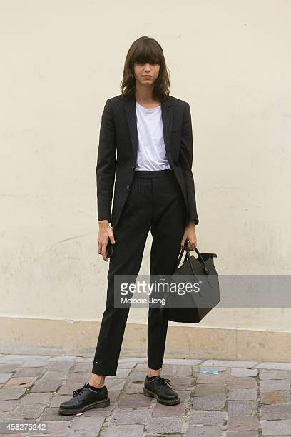 Argentinian model Mica Arganaraz exits the Sacai show carrying a Celine purse at Le Couvent des Cordeliers on Day 7 of Paris Fashion Week...