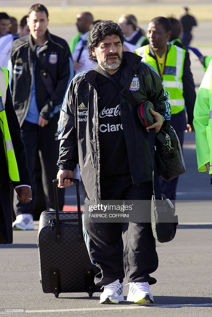 Argentinian national football team coach Diego Maradona arrives at the O. R. Tambo international airport on May 29, 2010 in Johannesburg ahead of the 2010 FIFA World Cup in South Africa. Argentina will play their first match against Nigeria on June 12.