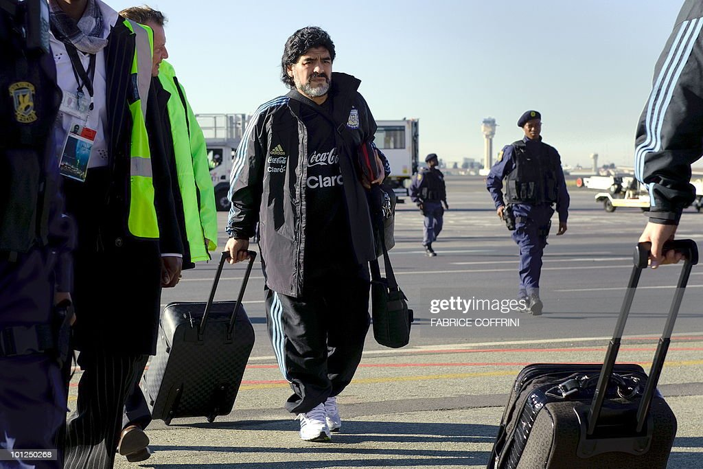 Argentinian national football team coach Diego Maradona arrives with his squad at the O. R. Tambo international airport on May 29, 2010 in Johannesburg ahead of the 2010 FIFA World Cup in South Africa. Argentina will play their first match against Nigeria on June 12.