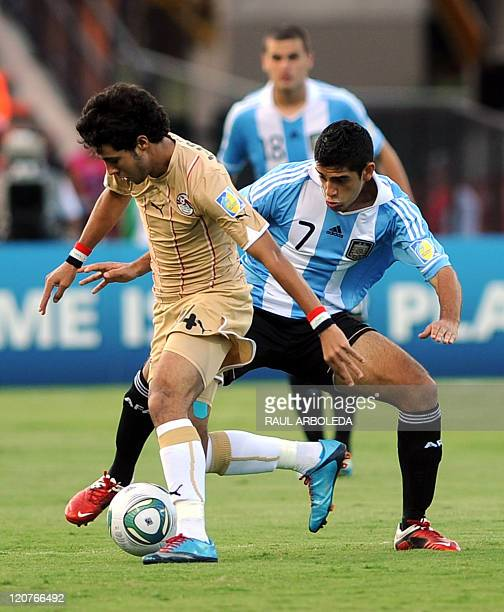 Argentinian player Matias Laba vies for the ball with Egypt's Mohamed Ibrahim during a FIFA Under20 World Cup football match held at the Atanasio...