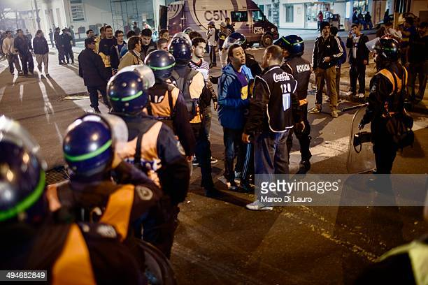 Argentinian Police officers search Boca Juniors soccer fans as they enter the stadium prior the football match between Racing and Boca Juniors as...