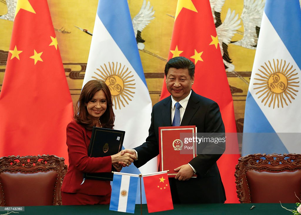 Argentinian President Cristina Fernandez de Kirchner (L) and Chinese President Xi Jinping shake hands and face the media after signing documents during a ceremony at the Great Hall of the People on February 4, 2015 in Beijing, China,. The Argentinian leader is on an official visit and is expected to meet with Chinese counterparts to boost bilateral ties.
