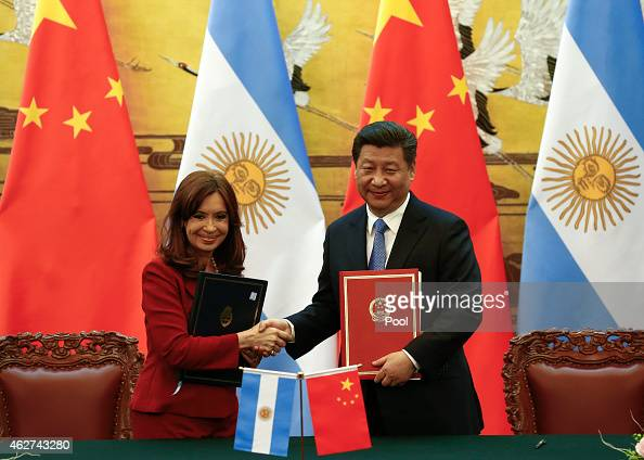 Argentinian President Cristina Fernandez de Kirchner and Chinese President Xi Jinping shake hands and face the media after signing documents during a...