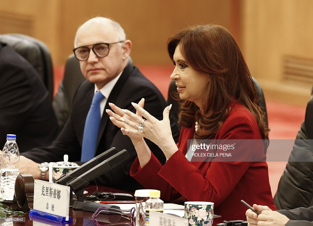 Argentinian President <a gi-track='captionPersonalityLinkClicked' href=/galleries/search?phrase=Cristina+Fernandez+de+Kirchner&family=editorial&specificpeople=565499 ng-click='$event.stopPropagation()'>Cristina Fernandez de Kirchner</a> (R) gestures as Argentinian Foreign Minister <a gi-track='captionPersonalityLinkClicked' href=/galleries/search?phrase=Hector+Timerman&family=editorial&specificpeople=6769851 ng-click='$event.stopPropagation()'>Hector Timerman</a> (L) looks on during a meeting with Chinese President Xi Jinping (not pictured) at the Great Hall of the People in Beijing on February 4, 2015. The Argentinian leader is on an official visit to boost bilateral ties.
