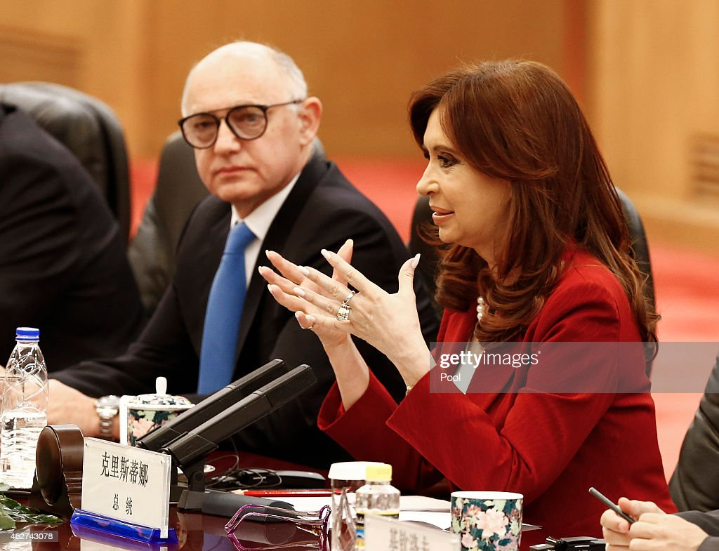 Argentinian President Cristina Fernandez de Kirchner (R) gestures as Argentinian foreign minister Hector Timerman (L) looks on during a meeting with Chinese President Xi Jinping (not in photo) at the Great Hall of the People on February 4, 2015 in Beijing, China,. The Argentinian leader is on an official visit and is expected to meet with Chinese counterparts to boost bilateral ties.