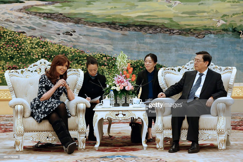 Argentinian President Cristina Fernandez de Kirchner speaks to chairman of the Standing Committee of China's National People's Congress, Zhang Dejiang during their meeting at the Great Hall of the People on February 5, 2015 in Beijing, China,. The Argentinian leader is on an official visit and is expected to meet with Chinese counterparts to boost bilateral ties.