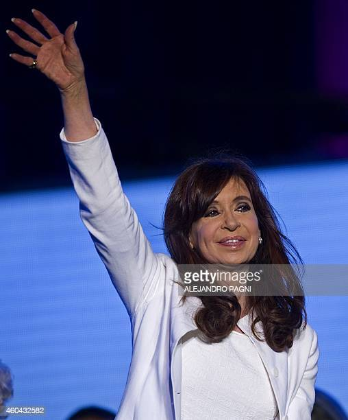 Argentinian President Cristina Fernandez de Kirchner waves to supporters at Plaza de Mayo on December 13 during a celebration of the Day of Democracy...
