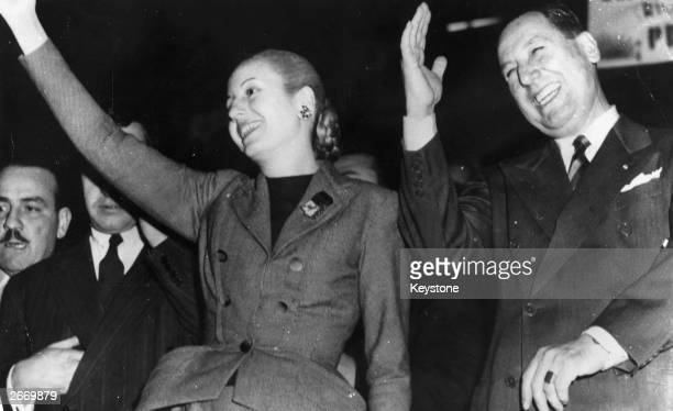Argentinian president Juan Peron and his wife Eva Peron saluting a demonstration in their honour at Buenos Aires