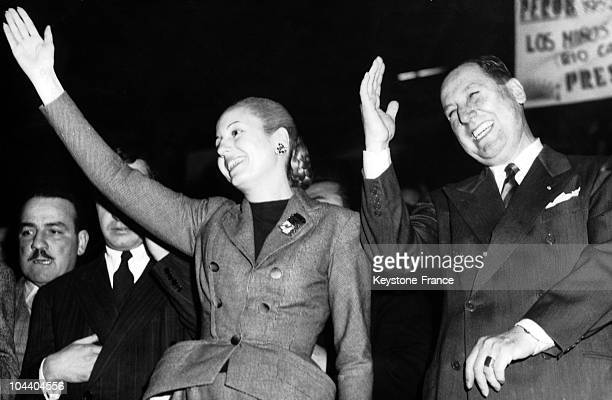 Argentinian President Juan PERON and his wife Eva PERON saluting the crowd in Luna Parc in Buenos Aires during their electoral meeting for the...