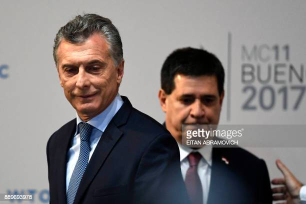 Argentinian President Mauricio Macri and his Paraguayan counterpart Horacio Cartes arrive to attend the opening ceremony of the 11th Ministerial...