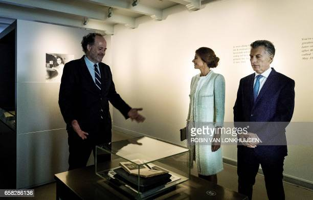 Argentinian president Mauricio Macri and his wife Juliana Awada visit the Anne Frank House during a state visit in Amsterdam on March 27 2017 / AFP...
