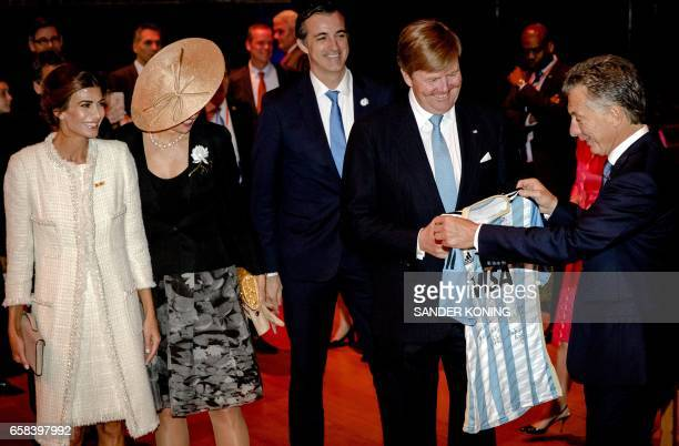 Argentinian President Mauricio Macri gives a football jersey to Dutch King WillemAlexander during a visit with his wife Juliana Awada and Dutch Queen...
