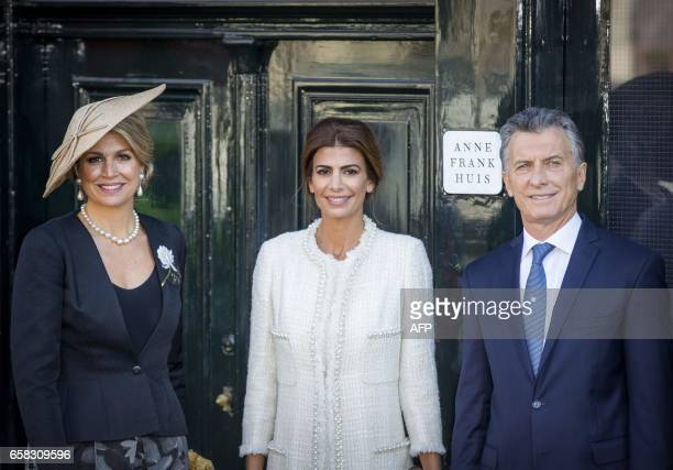 Argentinian president Mauricio Macri his wife Juliana Awada and Dutch queen Maxima pose in front of the House of Anne Frank in Amsterdam on March 27...