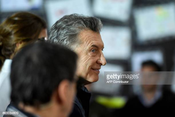 Argentinian President Mauricio Macri leaves after casting his vote during the legislative election in Buenos Aires on October 22 2017 Macri's...