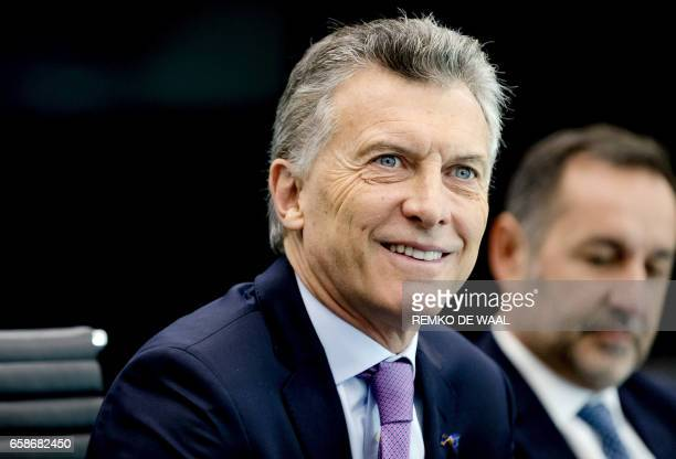 Argentinian President Mauricio Macri smiles during a visit to the International Criminal Court in The Hague The Netherlands on March 28 2017 / AFP...