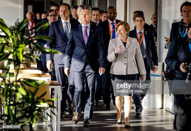 Argentinian President Mauricio Macri walks during a visit to the International Criminal Court in The Hague The Netherlands on March 28 2017 / AFP...