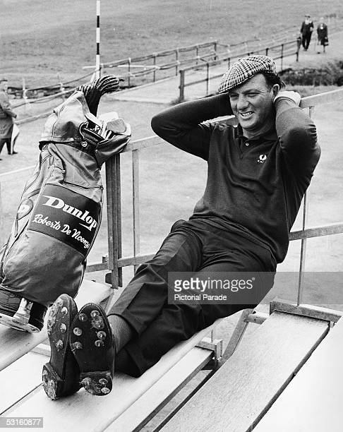 Argentinian professional golfer and British Open defending champion Roberto DeVicenzo takes a break on the steps of a player's hut at the Carnoustie...
