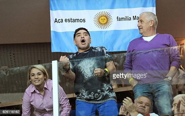 Argentinian retired professional footballer Diego Armando Maradona and his girlfriend Rocio Oliva react during the Davis Cup World Group final...