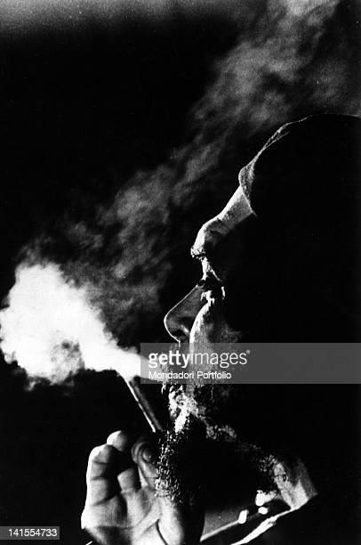 Argentinian revolutionary Ernesto Che Guevara smoking 1960s
