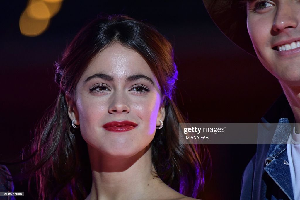 Argentinian singer and actress Martina Stoessel (L) poses with actor Jorge Blanco (R) before the premiere of the movie Tini - La Nuova Vita Di Violetta (Tini - The New Life of Violetta), on april 29,2016 in Rome. / AFP / TIZIANA