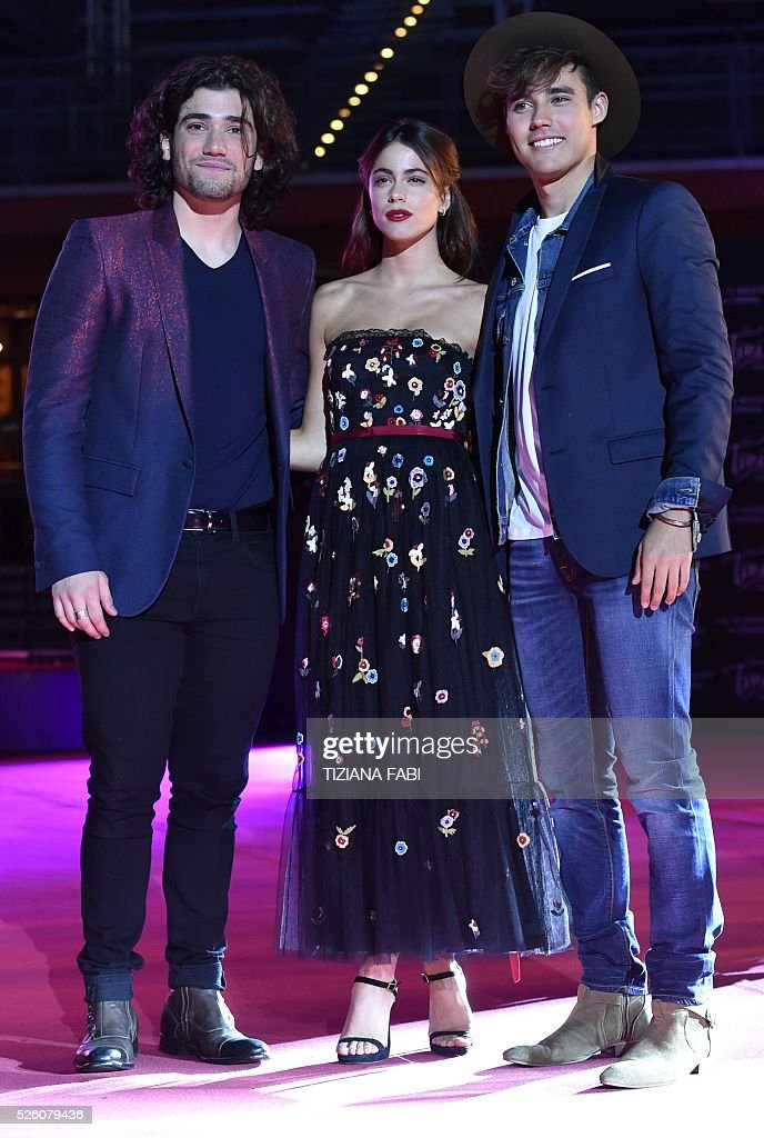 Argentinian singer and actress Martina Stoessel (C) poses with actors Jorge Blanco (R) and Adrian Salzedo (L) before the premiere of the movie Tini - La Nuova Vita Di Violetta (Tini - The New Life of Violetta), on april 29,2016 in Rome. / AFP / TIZIANA