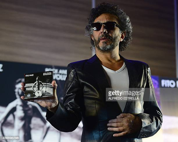 Argentinian singer Fito Paez poses for photographers before a press conference to present his new work 'Rock and Roll Revolution' a tribute to...