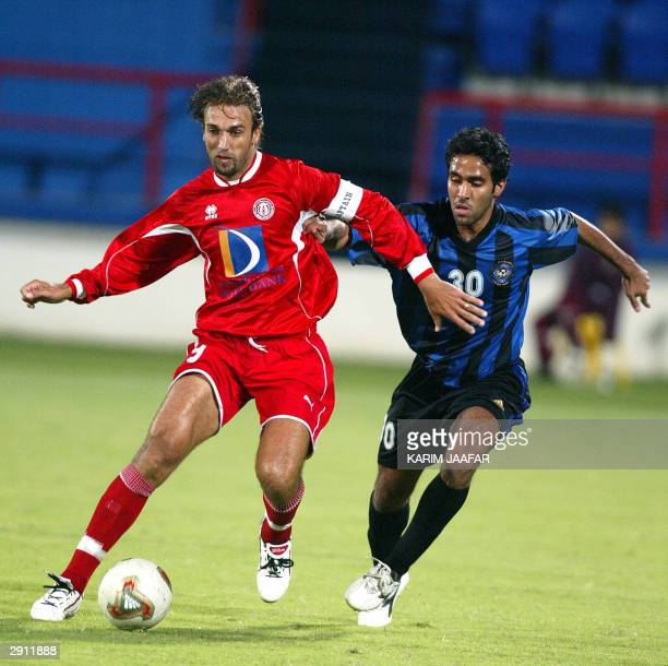 Argentinian soccer star and now Qatar's AlArabi club player Gabriel Batistuta vies with an unidentified player from fellow alSailiyah club during...