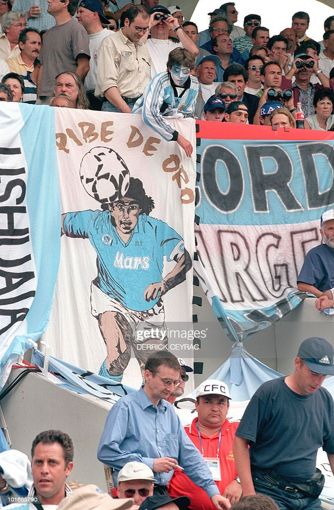 Argentinian supporters display a Maradona banner 26 June at Parc Lescure stadium in Bordeaux before the 1998 Soccer World Cup group H first round...