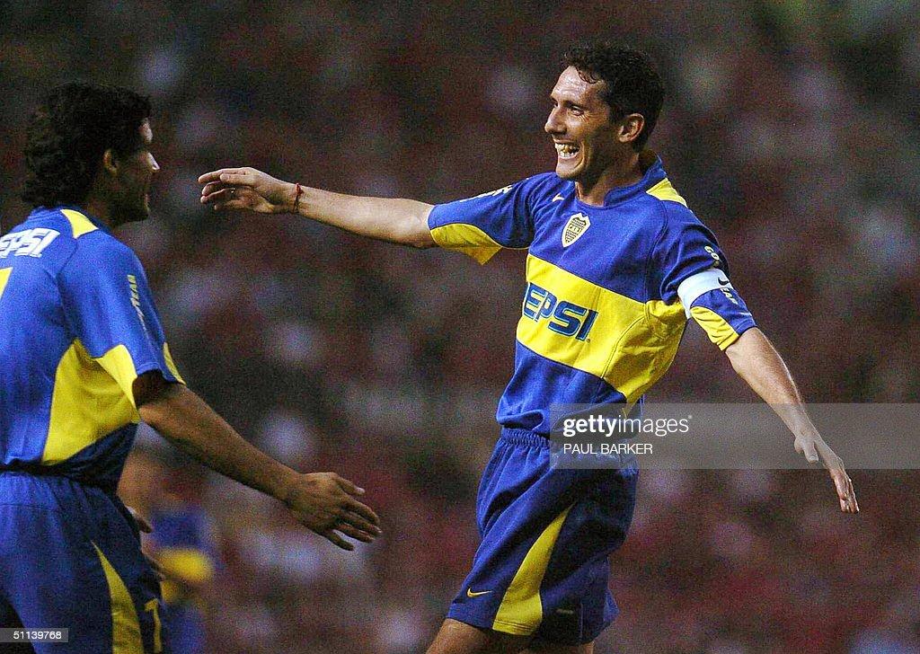 Argentinian team Boca Juniors player Diego Cagna celebrates with Ariel Carreno his team's fourth goal against Japanese team Urawa Red Diamonds 03...