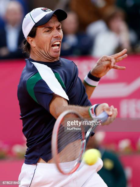 Argentinian tennis player Carlos Berlocq reacts during his Millennium Estoril Open ATP Singles 2nd round tennis matchragainst French tennis player...