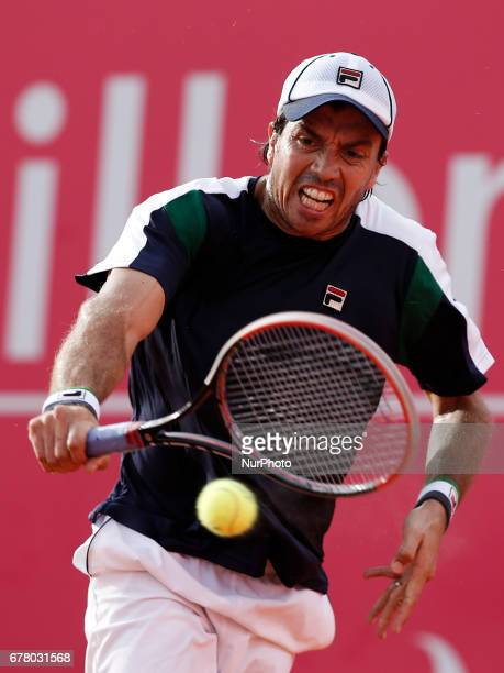 Argentinian tennis player Carlos Berlocq returns the ball to French tennis player Richard Gasquet during their Millennium Estoril Open ATP Singles...