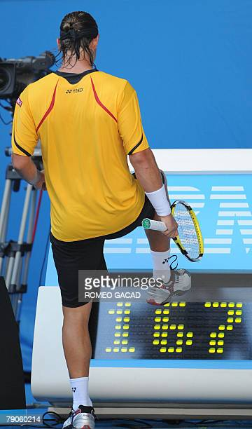 Argentinian tennis player David Nalbandian kicks at a ball speed indicator board during his mens singles match against Australian Peter Luczak at the...