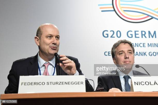 Argentinian Treasury Minister Nicolas Dujovne and Argentinian Central Bank governor Federico Sturzeneger give a press conference at the World Bank...