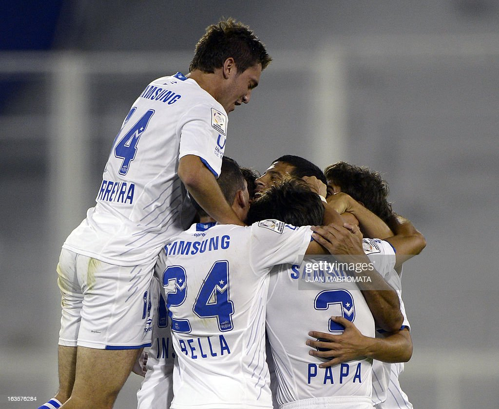 Argentinian Velez Sarsfield's defender Sebastian Dominguez (C) celebrates with teammates after scoring a goal against Uruguay's Penarol during their Copa Libertadores 2013 group 4 football match at Jose Amalfitani stadium in Buenos Aires, Argentina, on March 12, 2013. AFP PHOTO / Juan Mabromata