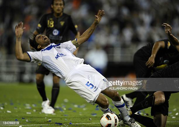 Argentinian Velez Sarsfield's midfielder Fabian Cubero is fouled by Ecuadorean Liga de Quito's defender Norberto Araujo during the second leg of...