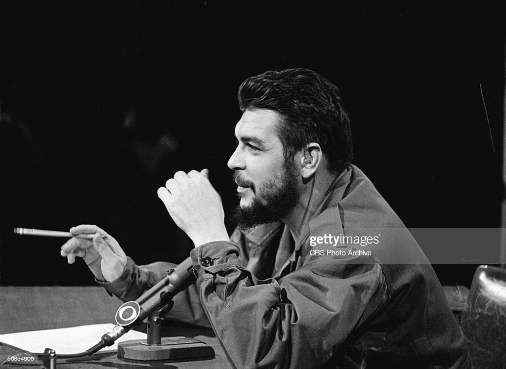 Argentinian-born Marxist revolutionary Ernesto Che Guevara (1928 - 1967), Cuban Minister of Industry, dressed in military fatigues, smokes a cigar and appears on the CBS current affairs program 'Face the Nation,' New York, New York, December 14, 1964.