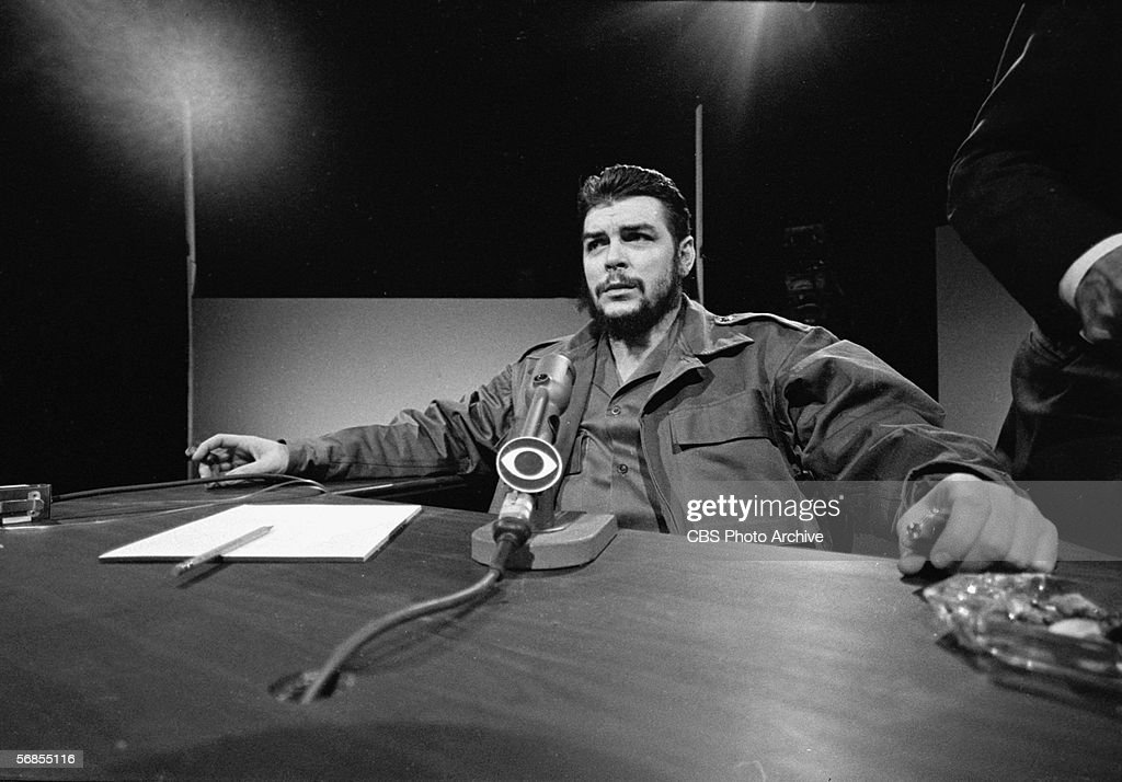 Argentinianborn Marxist revolutionary Ernesto Che Guevara Cuban Minister of Industry dressed in military fatigues reclines in his chair and smokes a...