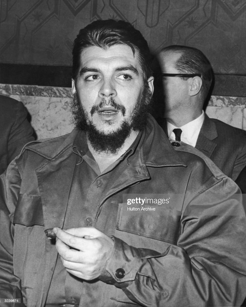 Argentinianborn revolutionary leader Ernesto 'Che' Guevara Minister of Industry for Cuba smokes a cigar after his speech at the UN General Assembly...