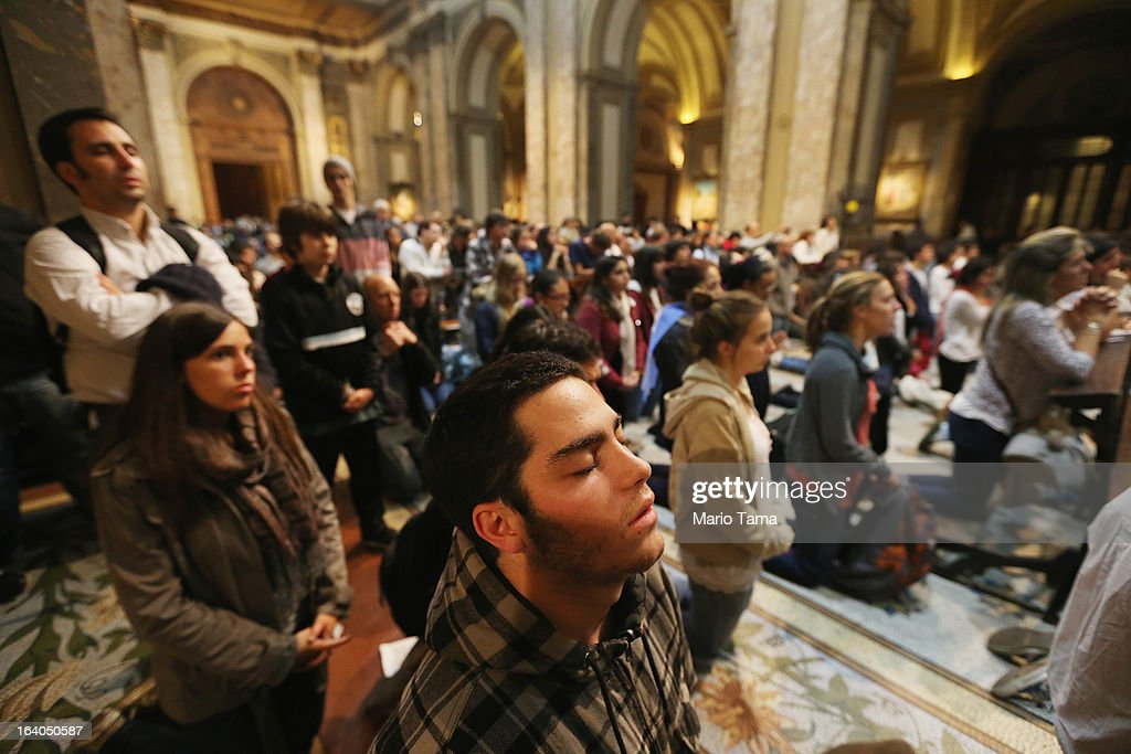 Argentinians gather in Metropolitan Cathedral during an overnight vigil while waiting to watch a live broadcast of the installation of Pope Francis in Saint Peter's Square on March 19, 2013 in Buenos Aires, Argentina. Francis was the archbishop of Buenos Aires and is the first Pope to hail from Latin America. Celebrants watched in the early morning hours as the event was broadcast at 6:00 a.m. Buenos Aires time.