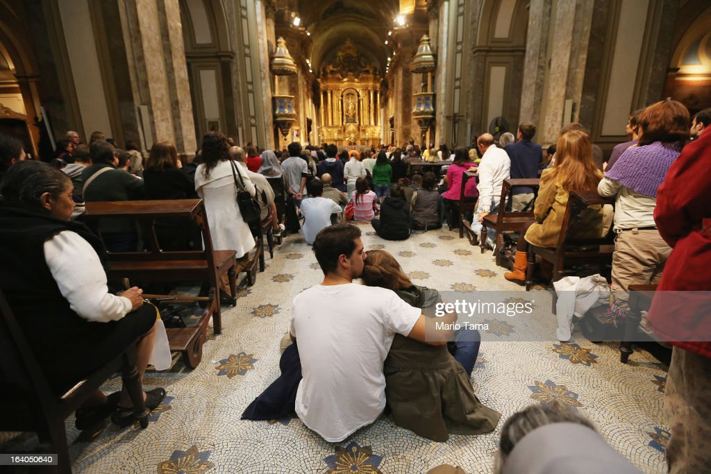 Argentinians gather in Metropolitan Cathedral during an overnight vigil while waiting to watch a live broadcast of the installation of <a gi-track='captionPersonalityLinkClicked' href=/galleries/search?phrase=Pope+Francis&family=editorial&specificpeople=2499404 ng-click='$event.stopPropagation()'>Pope Francis</a> in Saint Peter's Square on March 19, 2013 in Buenos Aires, Argentina. Francis was the archbishop of Buenos Aires and is the first Pope to hail from Latin America. Celebrants watched in the early morning hours as the event was broadcast at 6:00 a.m. Buenos Aires time.