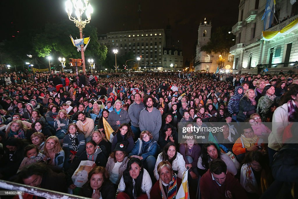 Argentinians gather in Plaza de Mayo while watching a live broadcast of the inauguration of Pope Francis in Saint Peter's Square on March 19, 2013 in Buenos Aires, Argentina. Francis was the archbishop of Buenos Aires and is the first Pope to hail from Latin America. Celebrants watched in the early morning hours as the event was broadcast at 6:00 a.m. Buenos Aires time.